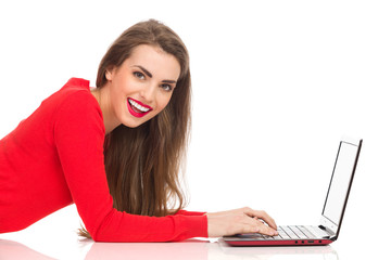 Beautiful girl working on a laptop
