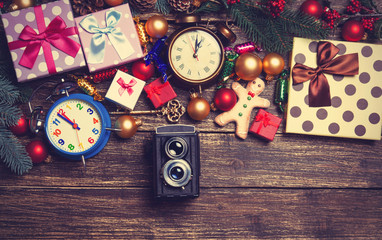 Camera, christmas gifts, gingerbread, alarm clocks
