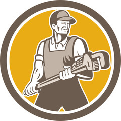 Plumber Holding Giant Wrench Retro Circle