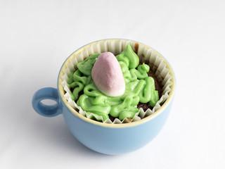 Cupcake de chocolatecon glaseado y gominolas