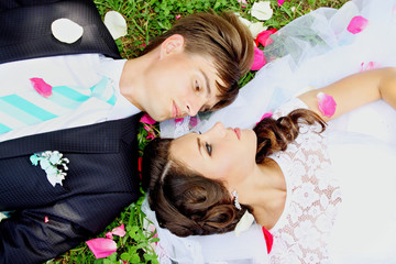newlyweds on grass, top view