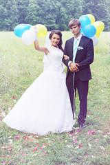 Newlyweds holding balls