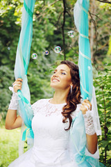 happy bride on a swing