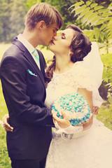 newlywed in a tender kiss