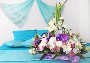 floral arrangement on the bed