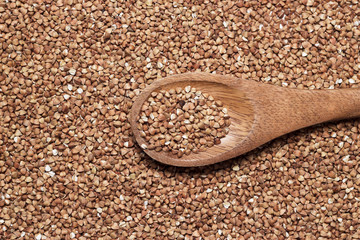 buckwheat and brown wooden spoon