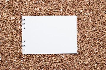 buckwheat with blank notepad