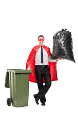 Superhero holding a large trash bag