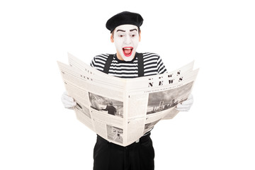 Male mime artist reading the news