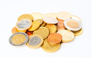 Heap of Euro coins on white background