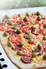 pizza with sausage and olives