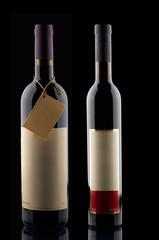 Two wine bottles on black background