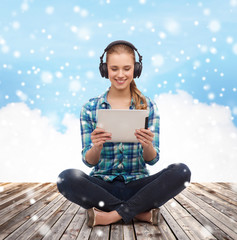 happy young woman with tablet pc and headphones