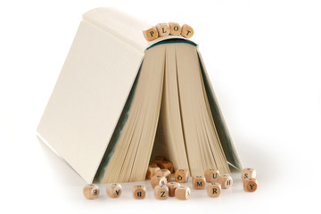 plot - message written in wooden letters on a story book