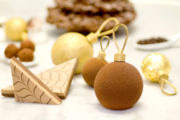 christmas chocolate baubles ahainst christmas sweets background