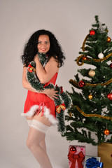 Girl Santa with Christmas tree and gifts, red costume