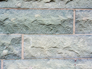 Mauer aus behauenem Naturstein als Hintergrund