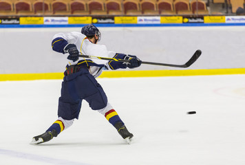 Ice Hockey - Player makes a slapshot