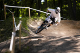 Mountainbiker rides on track in forest