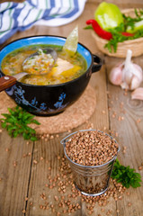 Soup with buckwheat groats on a wooden background