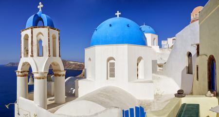 Twin churchs in Oia.Big panorama. Santorini, Greece
