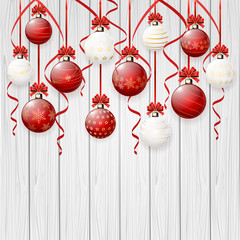 Red Christmas balls on white wooden background