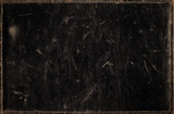 Black grunge background from distress leather texture
