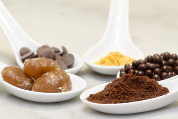 cocoa powder, chocolate pralineand drop,  marron glacee and gold