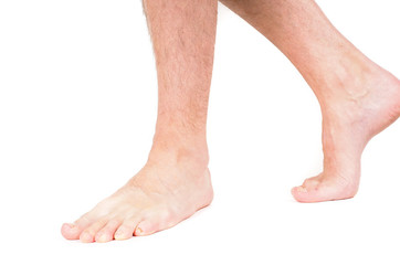 Young male person walking barefooted