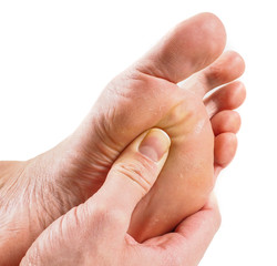 Male person receiving podiatry with pressure point technique und
