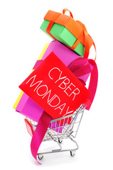 gifts in a shopping cart and signboard with the text cyber monda