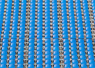 blue rows of seats on the stadium