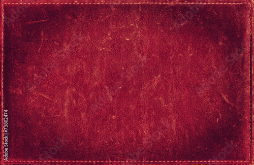 Red grunge background from distress leather texture - 73802474