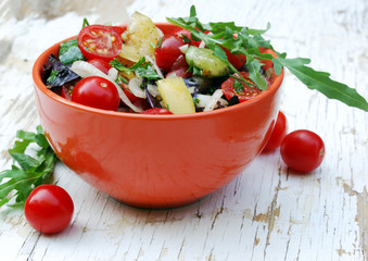 fresh summer salad with cherry tomatoes, basil leaves