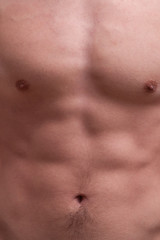 young muscle man chest and abdominals