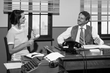 Vintage director and secretary working together at desk