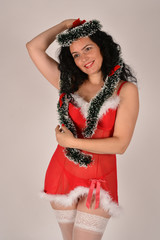 Girl Santa Claus, with Christmas tree ornaments, in red costume