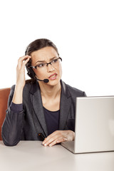positive girl working in the call center and carefully explained