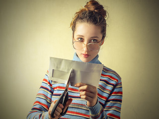 Girl cutting an envelop
