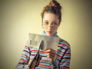 Girl cutting an envelop