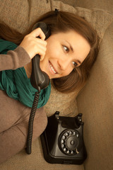 Young cheerful female on the  phone