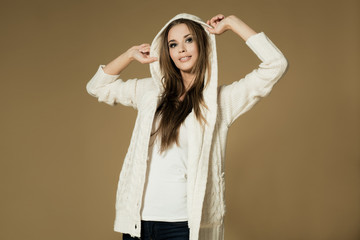 Gorgeous young brunette woman in warm sweater.