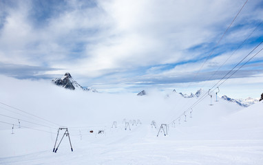 High altitude slopes and ski-lifts in Zermatt ski area