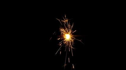 Sparkler burning on black background. 4K UHD 2160p footage.