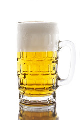 Mug with beer isolated on white