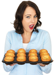 Young Woman Holding a Tray of Yorkshire Puddings
