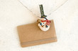 Christmas snowman clothespins holding greeting card