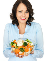 Young Woman Holding a Bowl of Mixed Vegetables