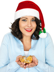 Young Woman in Santa Hat Holding Chocolate Money