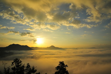 Mountain Landscape Above the Clouds at Sunrise